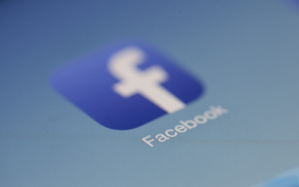 Facebook icon on a smartphone screen
