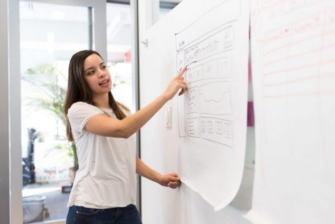 Woman at a whiteboard