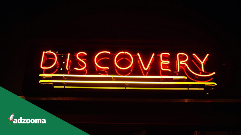 The word 'discovery' in neon lights
