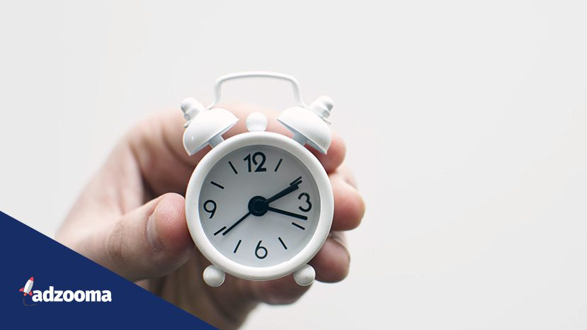 Person holding an alarm clock